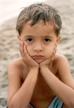 Sad boy on beach